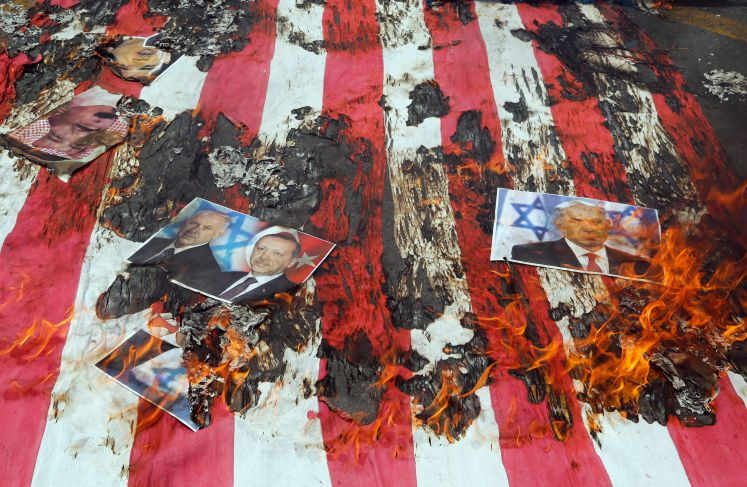 Iranians burn a US flag and portrait of Israeli Prime Minister Benjamin Netanyahu (R) and Turkish President Recep Tayyip Erdogan (2-R) during a rally marking Qods Day (Jerusalem Day), in support of Palestinian resistance against Israeli occupation, in Tehran, Iran, 01 July 2016.